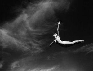 Woman Performing Swan Dive